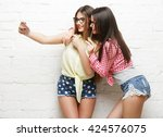 two young women  with party... | Shutterstock . vector #424576075