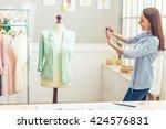 beautiful young designer is... | Shutterstock . vector #424576831