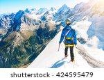 a climber reaching the summit... | Shutterstock . vector #424595479