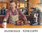 handsome young barista in apron ... | Shutterstock . vector #424611694