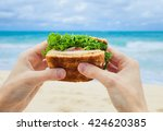 Hands Holding Healthy Sandwich...
