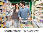 young couple shopping in a... | Shutterstock . vector #424621999