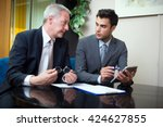 business people at work in... | Shutterstock . vector #424627855