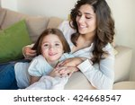 mother and daughter relaxing... | Shutterstock . vector #424668547