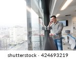 relaxed young businessman... | Shutterstock . vector #424693219