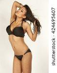 asian swimsuit model | Shutterstock . vector #424695607