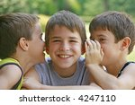 boys telling secrets | Shutterstock . vector #4247110