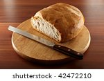 fresh sliced white bread on a wooden plate - stock photo