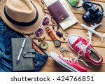 travel accessories on wooden... | Shutterstock . vector #424766851