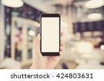hand holding the phone tablet... | Shutterstock . vector #424803631