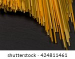 bunch of raw italian pasta with ... | Shutterstock . vector #424811461