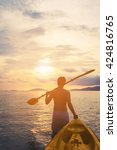 a guy pulling kayak to the sea... | Shutterstock . vector #424816765