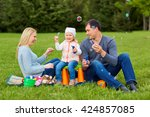 family playing with bubbles... | Shutterstock . vector #424857085