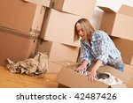 moving house  happy woman... | Shutterstock . vector #42487426