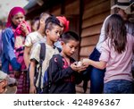 Small photo of Chiang Mai Thailand -January,21,2016:A Girl from happiness family learn how to share the happiness by giving ice cream to a boy in remote area Karen village in remote area in Chiang Mai Thailand