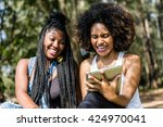 afro friends using tablet in... | Shutterstock . vector #424970041