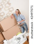 moving house  happy woman with... | Shutterstock . vector #42497071