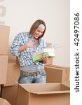 moving house  woman unpacking... | Shutterstock . vector #42497086