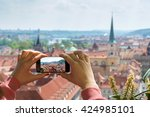 woman taking picture of old... | Shutterstock . vector #424985101