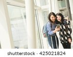 asian woman with her friend... | Shutterstock . vector #425021824