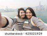 asian young girls take a selfie ... | Shutterstock . vector #425021929