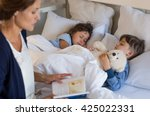 mother reading bed time stories ... | Shutterstock . vector #425022331