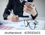 businesswoman using mobile | Shutterstock . vector #425032651