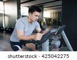 a man doing indoor biking in a...   Shutterstock . vector #425042275