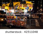 MANHATTAN - DECEMBER 4: A New York city street vendor get into the holiday spirit with lights on his cart on December 7, 2009 in New York City. - stock photo