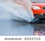 motion car rain big puddle of... | Shutterstock . vector #425127115