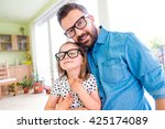 father with his little daughter ... | Shutterstock . vector #425174089