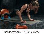 beautiful slim brunette doing... | Shutterstock . vector #425179699