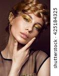 beautiful girl in a gold dress... | Shutterstock . vector #425184325
