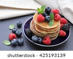 pancakes with berries.healthy... | Shutterstock . vector #425193139