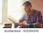 bearded man writing with pen... | Shutterstock . vector #425204245