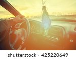 driver's hands on steering... | Shutterstock . vector #425220649