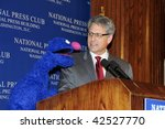 Small photo of WASHINGTON, DC - DECEMBER 8: Speaker Gary Knell is joined at the podium by Grover, one of the original Sesame Street muppets, at a National Press Club luncheon, December 8, 2009 in Washington, DC.