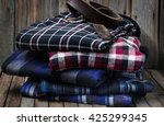 men's clothes  neatly stacked... | Shutterstock . vector #425299345