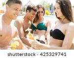 young people relaxing by the... | Shutterstock . vector #425329741