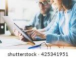 coworkers work modern studio... | Shutterstock . vector #425341951
