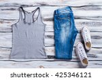 gray tank top and jeans. white... | Shutterstock . vector #425346121