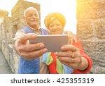 senior couple taking a selfie... | Shutterstock . vector #425355319