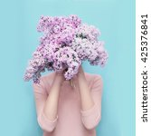 woman hiding head in bouquet... | Shutterstock . vector #425376841