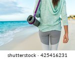 Fitness Woman Carrying Yoga Ma...