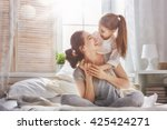 happy loving family. mother and ... | Shutterstock . vector #425424271