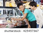 couple choosing product from... | Shutterstock . vector #425457367