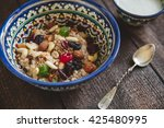 milk into a bowl and  plate of... | Shutterstock . vector #425480995