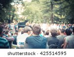 people sitting in park garden... | Shutterstock . vector #425514595