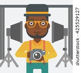 an african american man holding ... | Shutterstock .eps vector #425529127