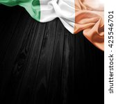 flag of ireland on dark wood... | Shutterstock . vector #425546701